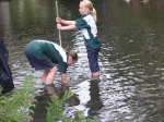 Collecting river samples at a BioBlitz in Christchurch